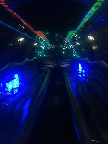 Interior picture of stretch Cadillac Escalade showing off a dazzling lighting display