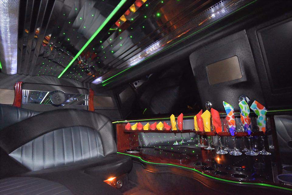 Interior picture of stretch 10 passenger Lincoln Towncar ready for a birthday party complete with champagne flutes and napkins and a stocked bar