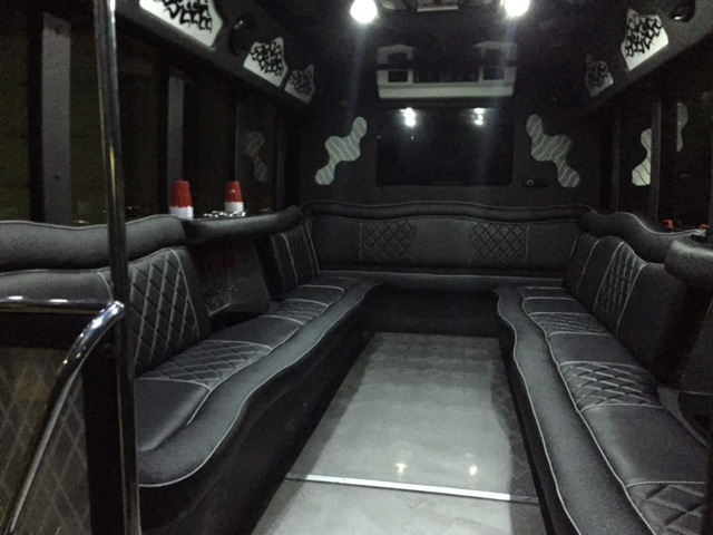 Interior picture of 22 passenger limo bus showing luxury leather seats