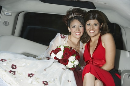 Friends celebrate a quinceanera by riding in a limo from mass to the party venue